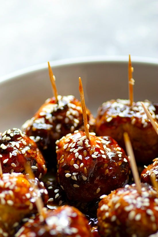 Instant Pot Honey Sesame Glazed Chicken Meatballs - The instant pot makes these honey sesame glazed chicken meatballs SUPER tender and they're smothered to perfection in a sweet 'n' savory honey sesame sauce! The BEST app you'll ever make.