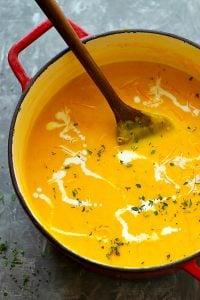 Pumpkin Beer Cheese Soup - Creamy pumpkin beer cheese soup is going to be your FAVORITE way to warm up! Flavorful beer, silky fresh pumpkin puree, and tons of cheddar build SO much flavor in this cozy soup.