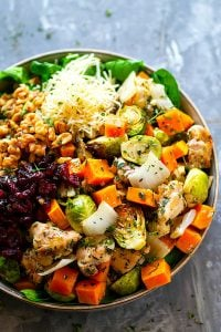 Honey Rosemary Roast Chicken Spinach Salad - Need a stunner holiday salad? This honey rosemary roast chicken spinach salad features juicy roast chicken, toasty nuts, dried cranberries, and a huge pile of beautiful roasted autumn vegetables!