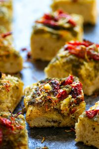 Roasted Garlic Sun-Dried Tomato Pesto Focaccia - Tangy sun-dried tomatoes and nutty roasted garlic deliver MASSIVE flavors in this incredibly soft pesto focaccia! Making it overnight makes it SO easy to prepare.
