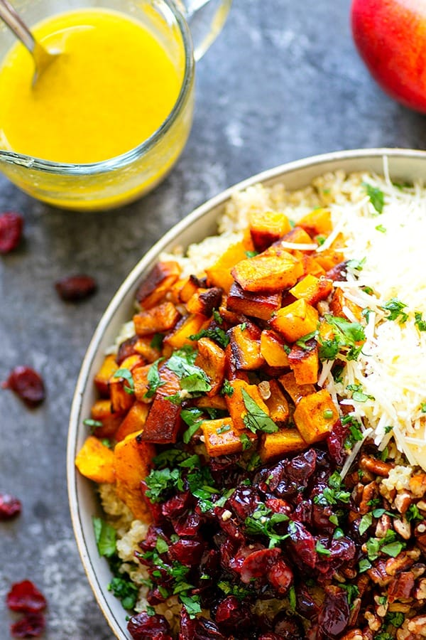 Cranberry Apple Delicata Squash Quinoa Salad - Loaded with tangy cranberries and crunchy apples, this delicata squash quinoa salad is the perfect winter side salad for any gathering and doubles as fantastic lunch leftovers!