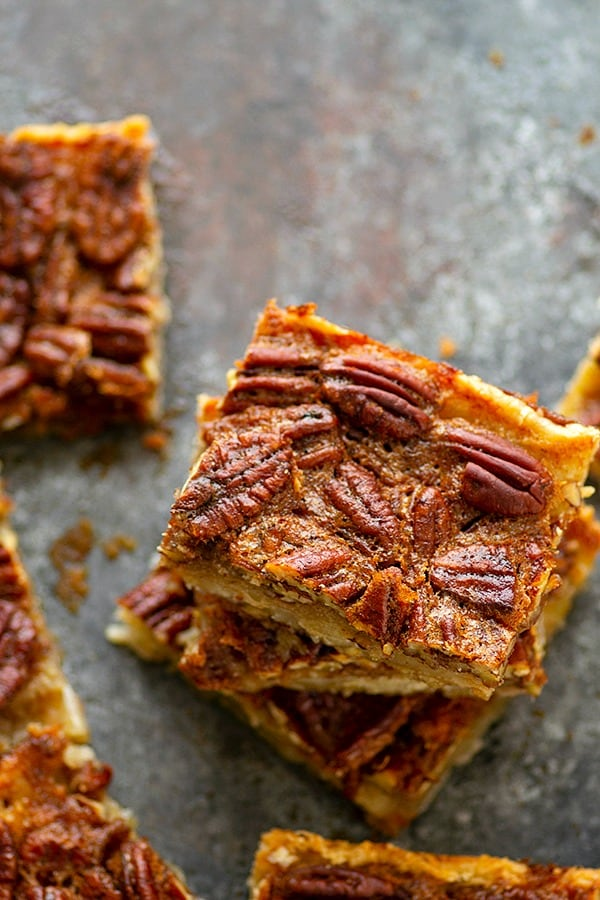 Maple Pecan Slab Pie - Make your pies the EASY way for a crowd this holiday season with this ridiculously addicting maple pecan slab pie! The flaky pie crust and maple pecan filling is an instant crowd pleaser.
