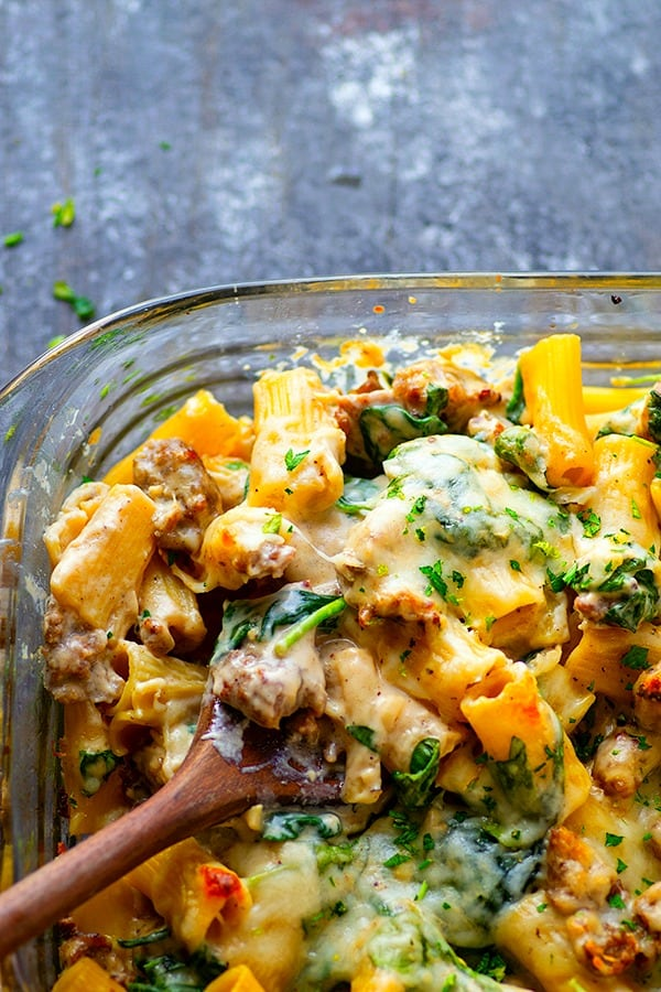 Baked Spinach White Alfredo Sausage Ziti - Flavorful sausage bits and a creamy spinach alfredo sauce transform your typical baked ziti into this incredibly comforting spinach white alfredo sausage ziti.