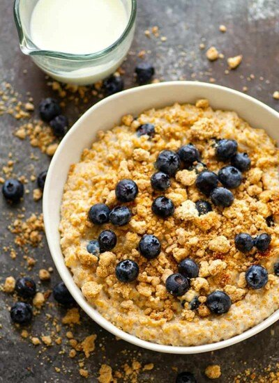 Blueberry Muffin Streusel Steel-Cut Oatmeal Bowls - Juicy fresh blueberries and buttery homemade streusel take these creamy steel-cut oatmeal bowls to a WHOLE other breakfast level!