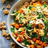 Warm Sweet Potato Kale Salad - Warm roasted sweet potatoes and tender sauteed kale are tossed in a flavorful tahini dressing for a hearty sweet potato kale salad that's on the lighter side!