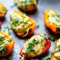 Pesto Stuffed Sweet Pepper Poppers - Stuffed with a super flavorful creamy pesto filling, these pesto stuffed sweet pepper poppers are SUPER addicting and the perfect little party app!
