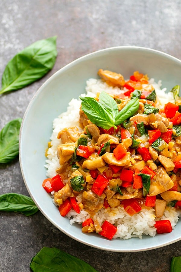 Lighter Instant Pot Thai Basil Chicken - Lighter on the calories and made completely in the instant pot, this thai basil chicken is loaded with fresh basil flavor, soft sweet peppers, and tender chicken cubes.
