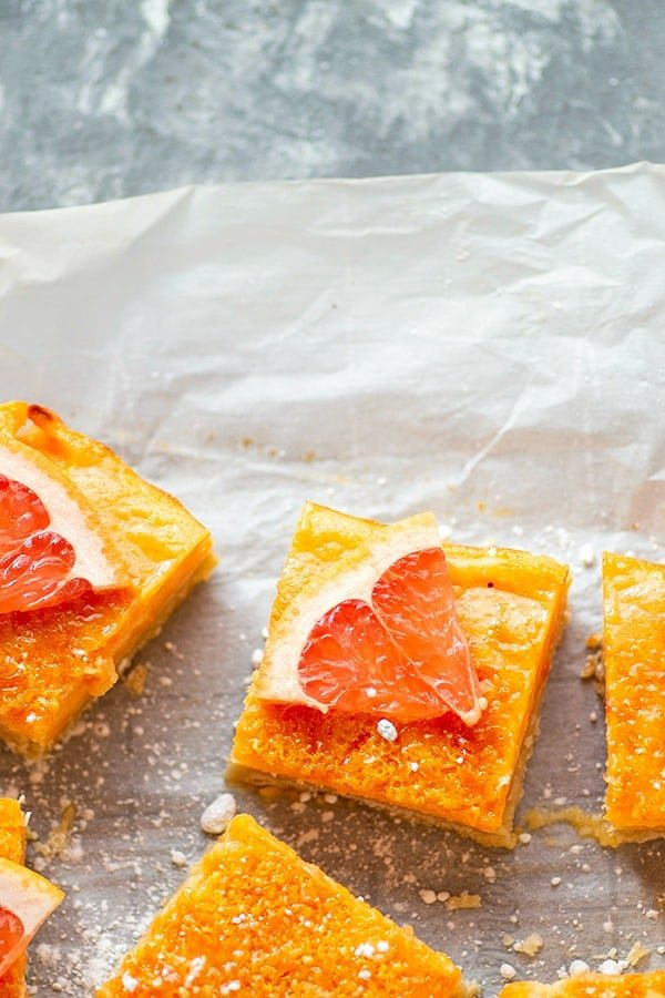 Shortbread Grapefruit Bars - Buttery shortbread crust and a luscious grapefruit filling are an incredible duo in these tangy shortbread grapefruit bars that are the perfect way to use up extra citrus fruit!