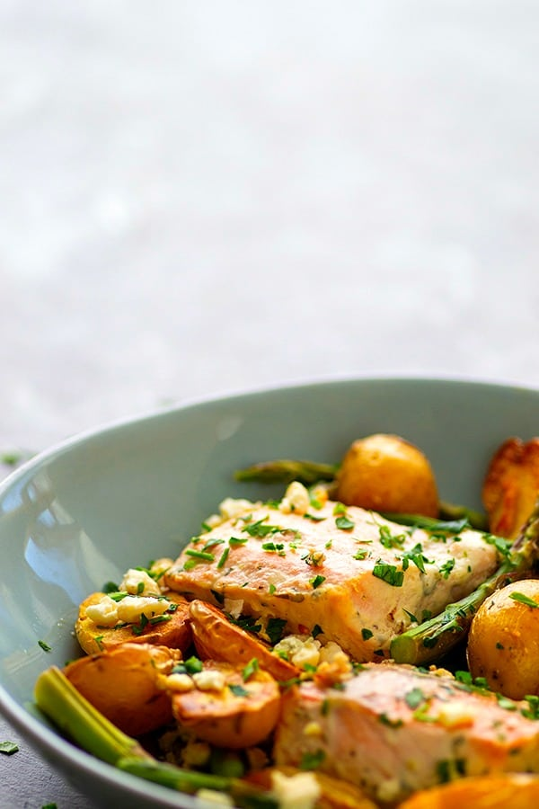 Sheet Pan Greek Salmon - Made entirely on one sheet pan and packed FULL of incredible Greek flavors, this Greek salmon and fingerling potatoes will quickly become a regular part of the dinner rotation!