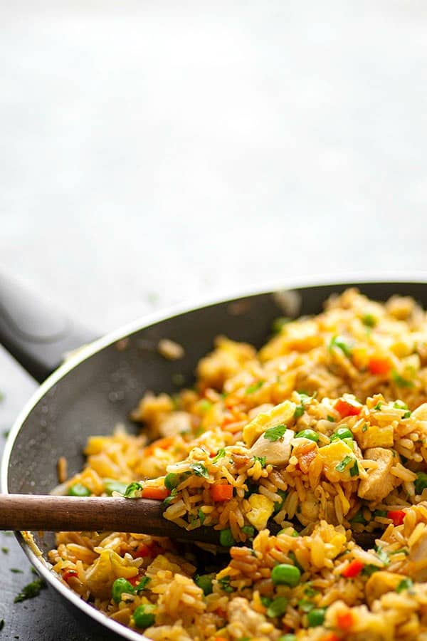 Cilantro lime marinated chicken is the secret behind what makes this cilantro lime chicken fried rice SO incredibly flavorful.--You'll love this fried rice more than your favorite Chinese place!
