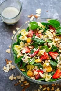 Juicy strawberries, crumbly feta, and a tangy poppyseed dressing transform this spinach pasta salad into a vibrant, flavor-packed salad that's perfect for a lighter dinner or a cookout side dish!