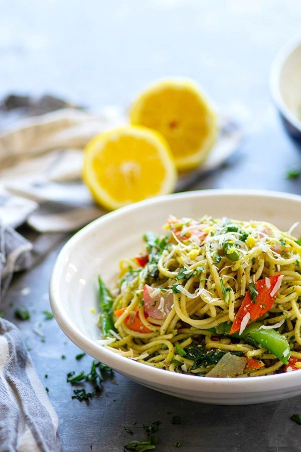 Tossed in a flavorful lemon pesto and packed with colorful spring vegetables, this pesto pasta primavera is the perfect way to use up that fresh spring produce!