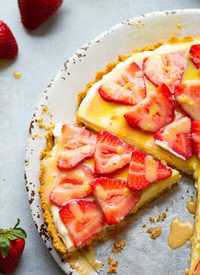 Incredibly light and silky strawberry cheesecake tart is the easiest no-bake dessert to make when you want an easy showstopper! You won't be able to get enough of the juicy strawberries, fluffy cheesecake filling, and tangy homemade lemon curd.