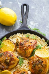 A zingy dill lemon sauce coats crispy pan-seared lemon chicken thighs that are heavenly served on top of a pile of incredibly creamy mascarpone rice!