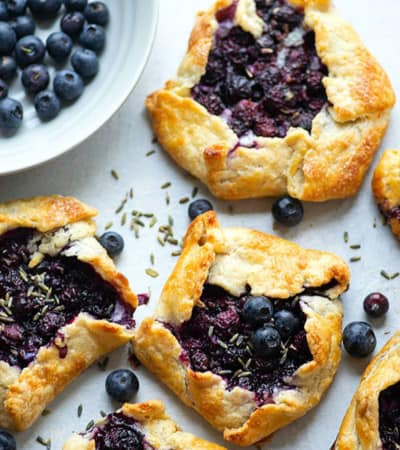 Fragrant lavender, creamy mascarpone, and juicy blueberries are a trio made in heaven in these mini blueberry galettes! Perfectly mini-sized for a handheld summer dessert.
