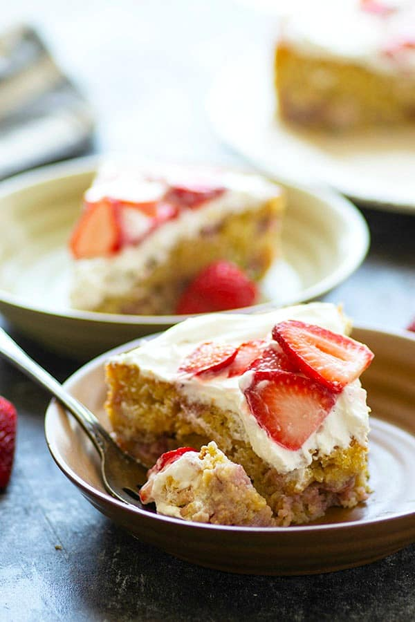 Light, tender cornmeal cake is made with flavorful browned butter and studded with juicy fresh strawberries. Top this rustic cake with plenty of whipped cream and extra strawberries for ultimate summer flavors!