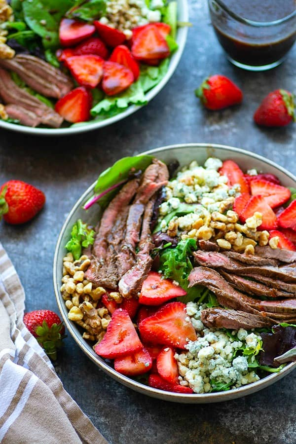 Loaded with juicy grilled steak strips, sweet strawberries, a tangy balsamic dressing, and plenty of bleu cheese, this grilled steak strawberry salad is the perfect lighter meal to make the most of strawberry season!