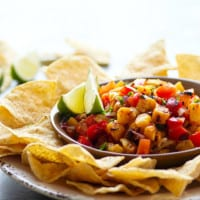Sweet grilled pineapple and smoky chipotle pepper take this addicting grilled pineapple salsa to an incredible level of flavors! Serve with your favorite chips, on tacos, or over grilled meat.