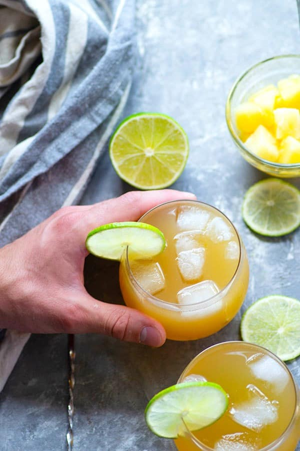 Spicy ginger, sweet pineapple juice, and tangy lime juice make for an incredibly smooth and flavorful pineapple gin cocktail that's perfect for entertaining!