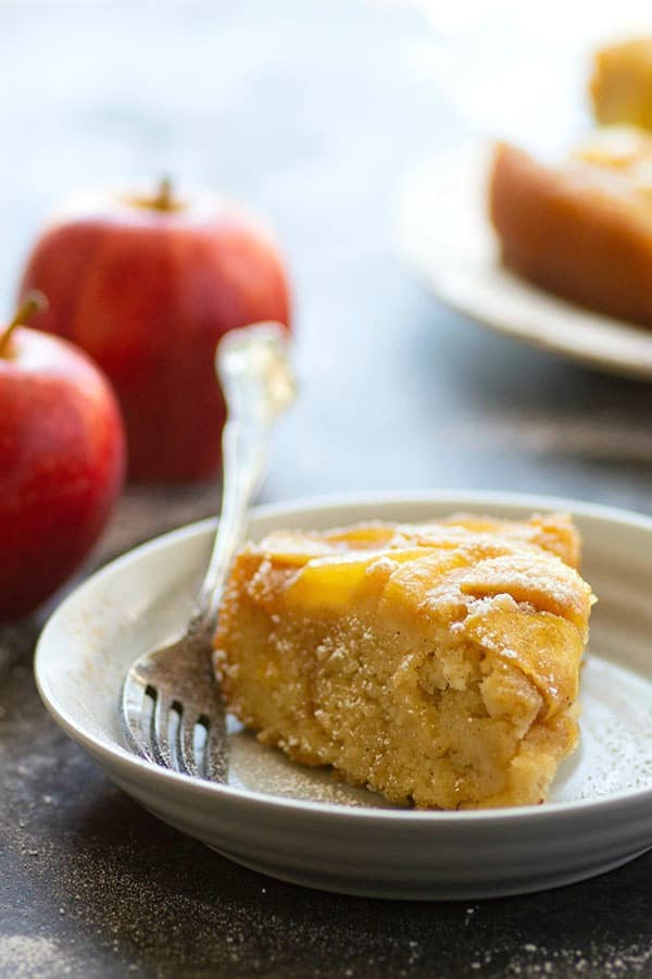 Rich ricotta and spiced rum in the cake batter and a caramel apple upside down topping make for an incredible cake duo in this stunning apple rum cake!