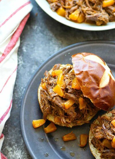 This pineapple BBQ beef is made in minutes using the instant pot! The beef is incredibly tender, sweet 'n' smoky, and amazing piled into a warm bun.