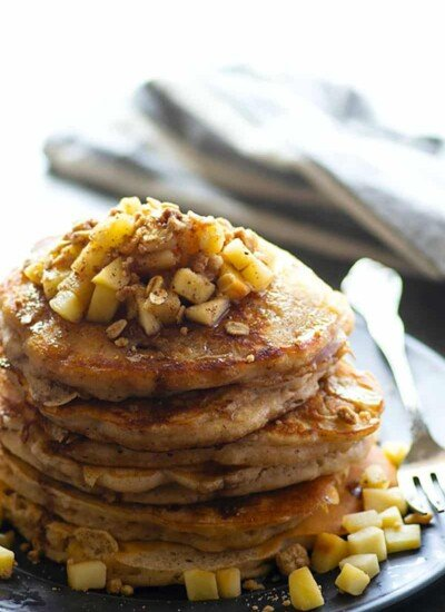 Piled high with a buttery oat streusel and a spiced maple syrup, these apple cinnamon pancakes are one incredible pancake breakfast for fall!