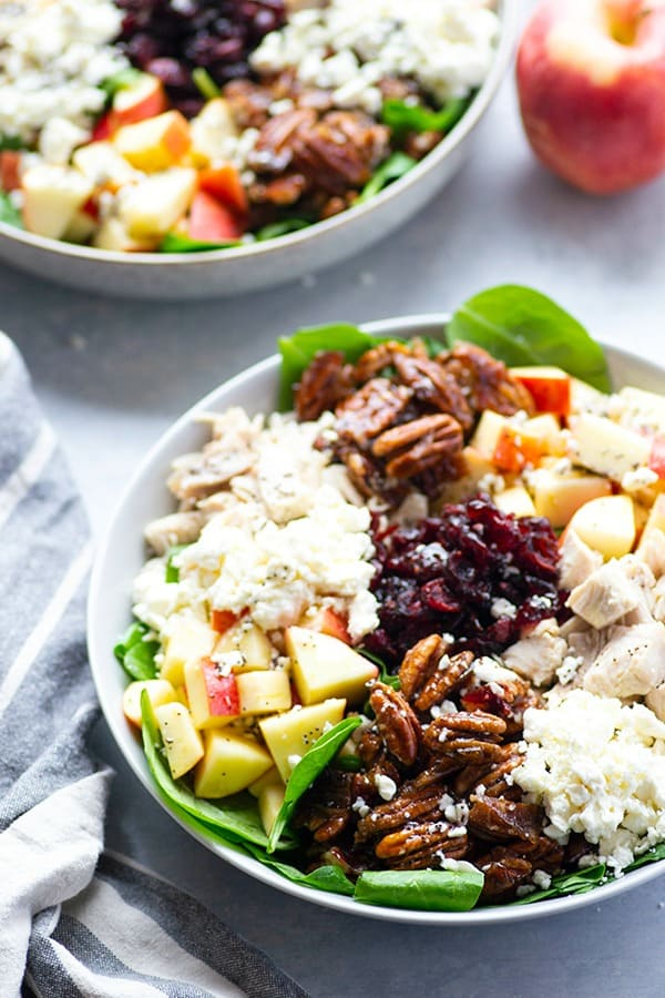 Packed with homemade candied pecans, juicy turkey cubes, and all the fall fixins', this apple spinach salad is the perfect way to incorporate all your favorite fall ingredients into one loaded salad!