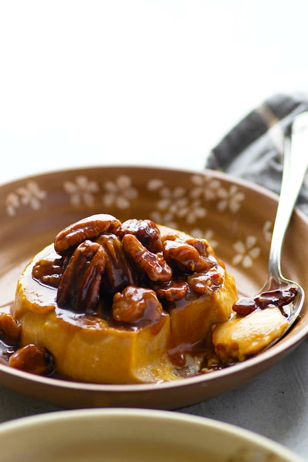 Silky smooth pumpkin panna cotta is heaped high with a sweet 'n' salty caramel pecan sauce and is guaranteed to wow in the fall dessert department!