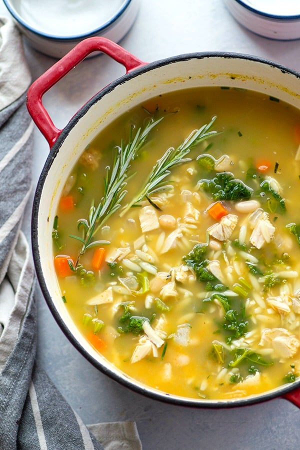 Brimming with fresh kale, orzo, and turkey in a rich white bean broth, this hearty kale white bean soup will instantly warm you up!