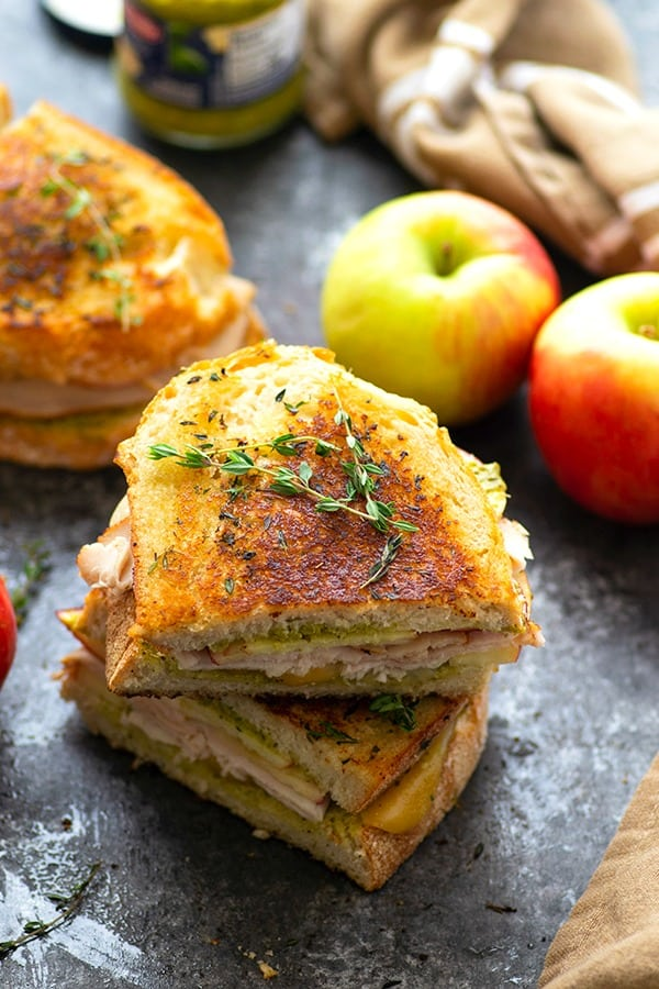 Turkey panini is layered with hearty turkey slices, crunchy apples, flavorful pesto, and gooey gouda cheese for one showstopper sandwich! -- this is the perfect panini for turkey leftovers!