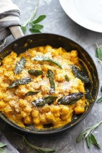 Loaded with pumpkin flavor, sharp Asiago cheese, and crispy fried sage, this creamy pumpkin alfredo gnocchi comes together in only 35 minutes and is the perfect festive fall side dish!