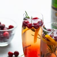 The poinsettia cocktail features tangy cranberry juice, bubbly champagne, and a kiss of orange liqueur creating an unmatchable holiday cocktail! Pour these festive drinks in only 5 minutes with 3 ingredients!