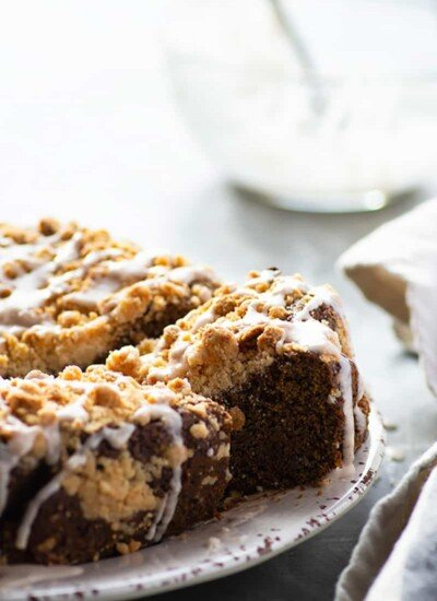 This festive gingerbread coffee cake is loaded with spicy ginger flavors, flavorful browned butter, and lots of buttery streusel topping and icing on top. -- perfect for a holiday brunch or dessert!