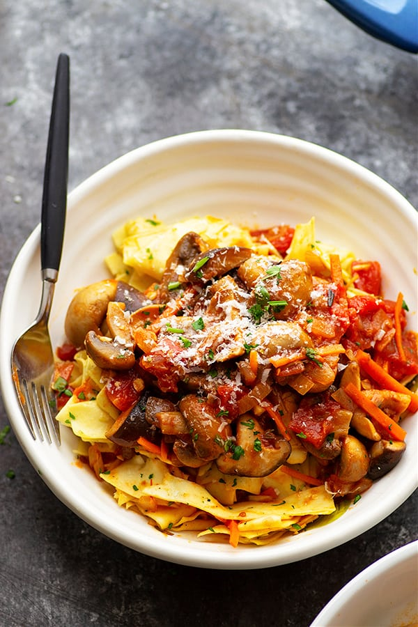 This cozy shiitake mushroom ragu features tender mushrooms in a rich tomato sauce and piled high over garlic butter pappardelle noodles. - a hearty dinner favorite AND vegetarian!