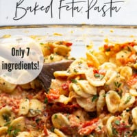 Baked feta and herby bursting cherry tomatoes cook down into the most luxurious creamy sauce EVER for pasta! Inspired from the viral TikTok recipe, this baked feta pasta will quickly become a dinner regular!