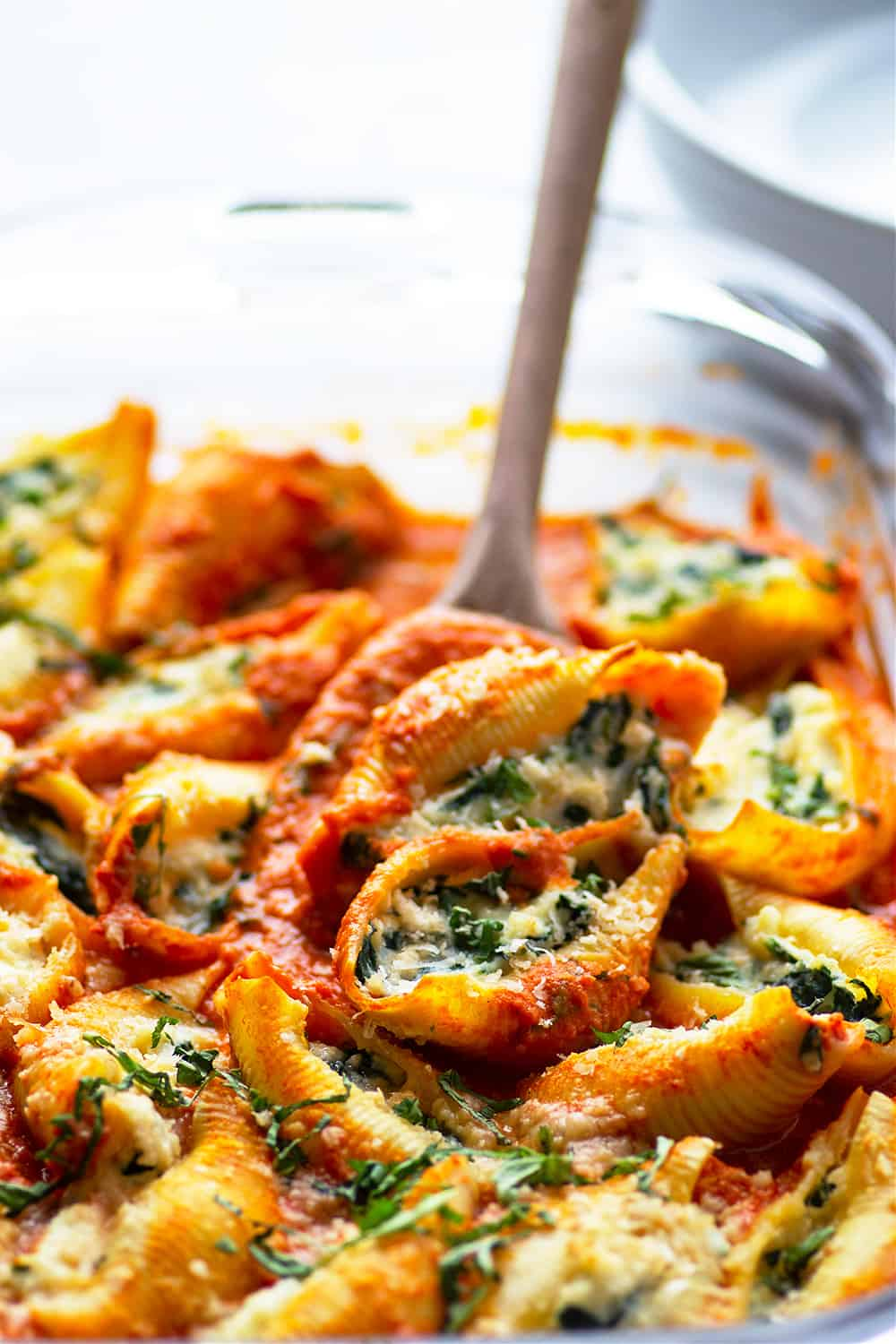 Stuffed with a creamy spinach ricotta filling and baked in a flavorful basil vodka sauce, these spinach ricotta stuffed shells are easy to prepare and will impress everyone you serve them to!