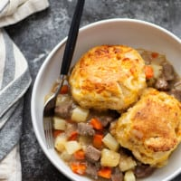 Loaded with steak and potatoes in a rich beer sauce and topped with buttery cheddar biscuits, this steak pot pie is an irresistible weeknight comfort food!
