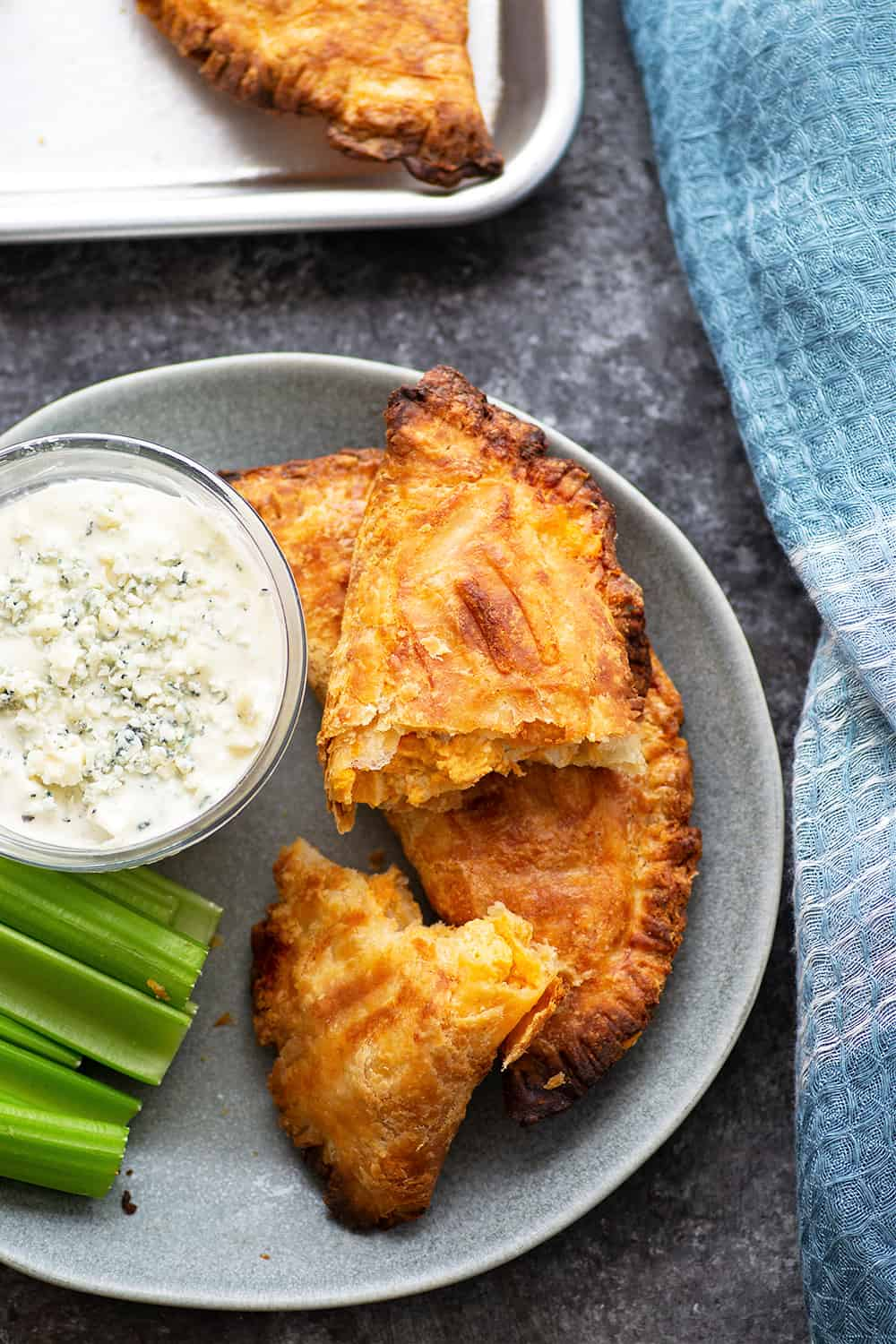 Crispy buffalo chicken empanadas are made entirely in the air fryer in MINUTES and stuffed with a spicy buffalo chicken filling. Serve these flaky empanadas with plenty of blue cheese dressing and celery sticks!