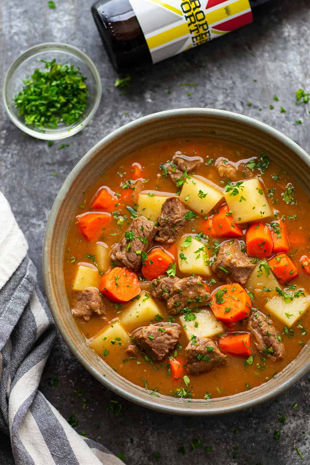 Irish beef stew is made entirely in the instant pot in only an hour and features tender beef cubes and vegetables in a rich stout sauce.