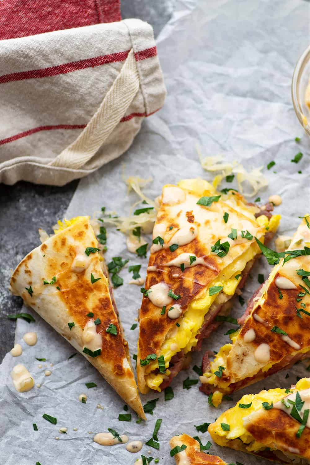 Loaded with all the classic Reuben sandwich fixins' and soft scrambled eggs, these breakfast corned beef quesadillas are fast to whip up and the perfect use for leftover corned beef!