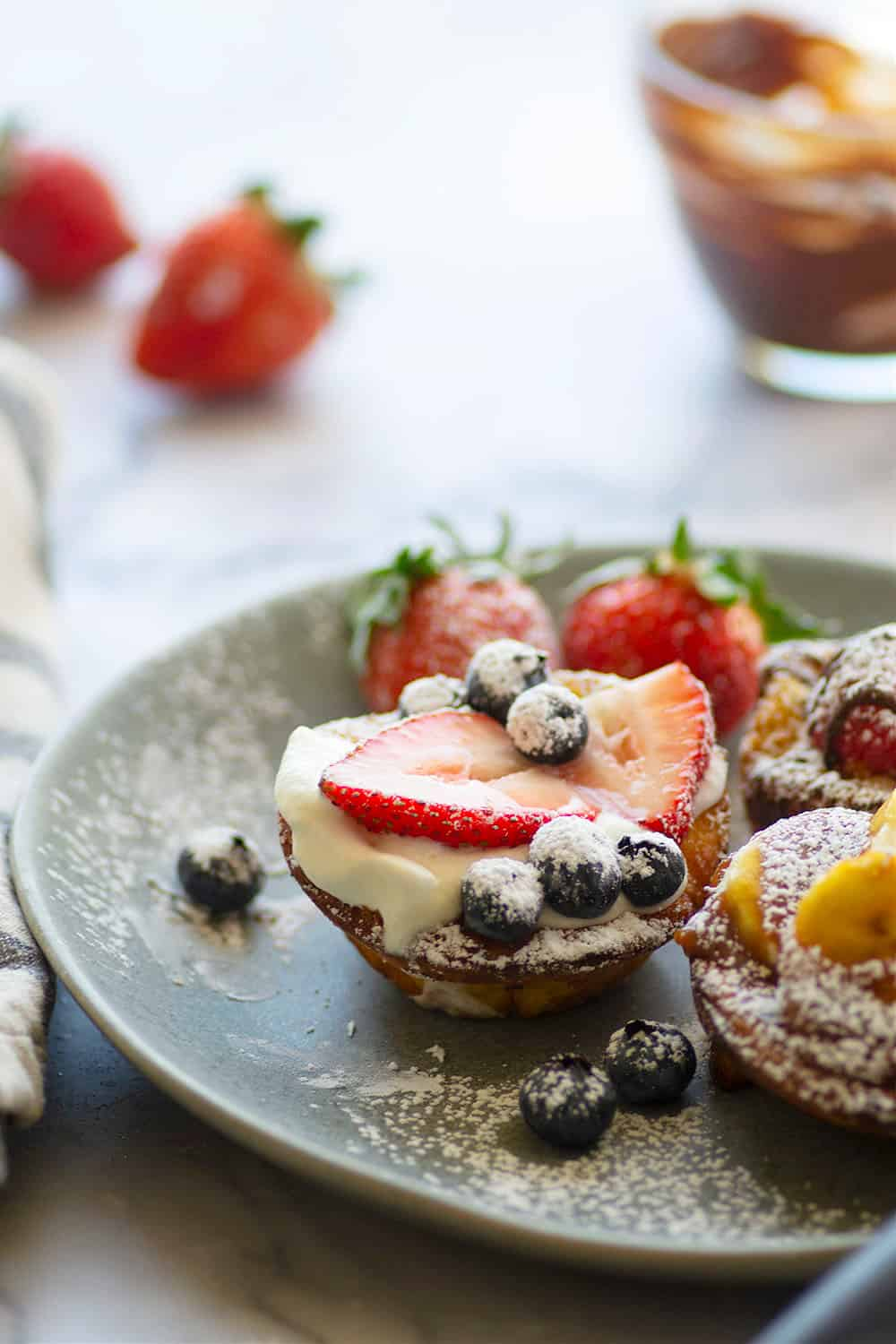 These mini dutch baby pancakes are a mini version of the classic dutch baby! Fill these buttery, tender dutch baby pancakes with a choice of three incredible fillings or your favorite pancake toppings.