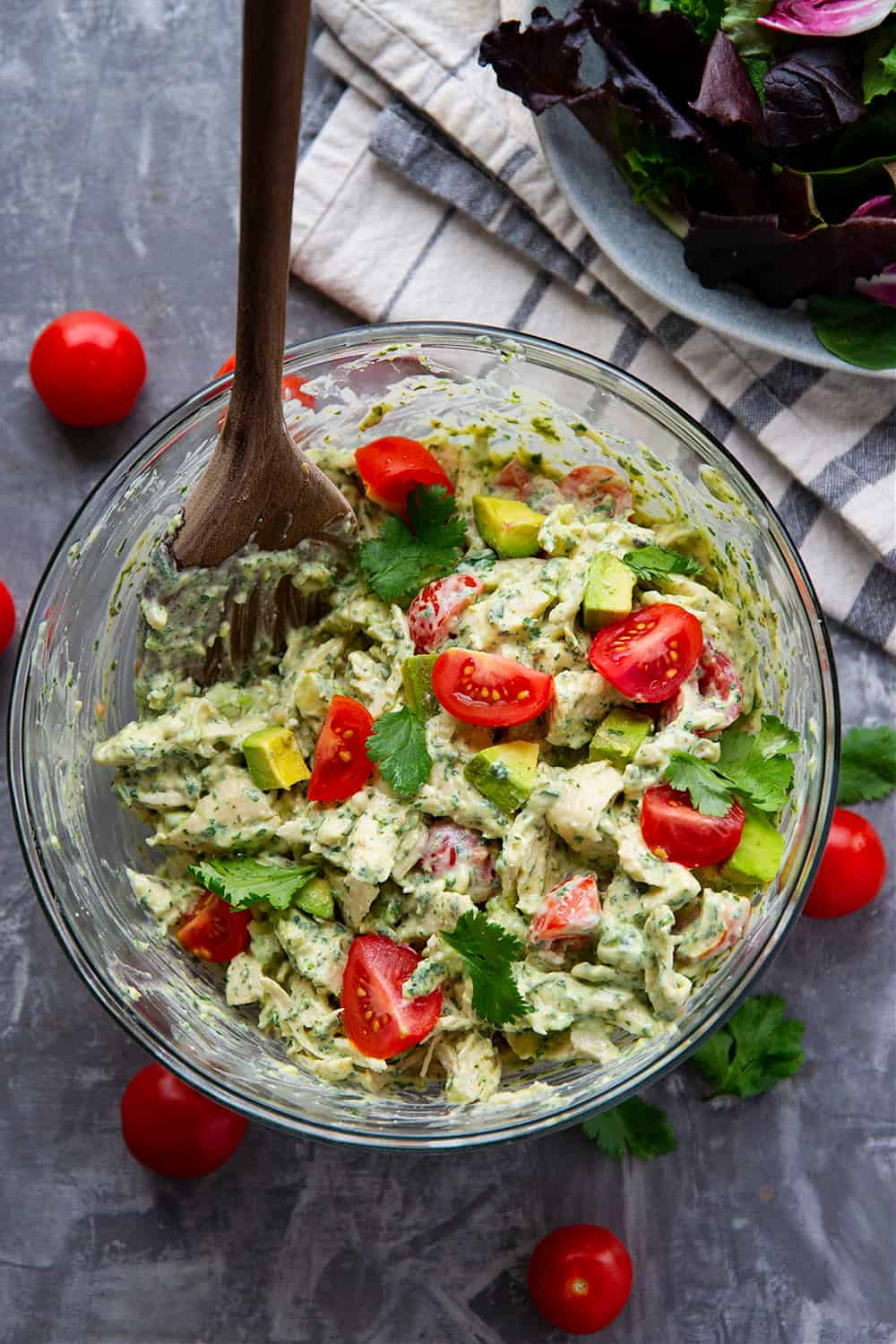 A creamy, herby homemade green goddess dressing gets tossed with shredded chicken and plenty of fresh cherry tomatoes and avocado in this green goddess chicken salad! - pile this flavorful chicken salad over greens or on sandwich buns.