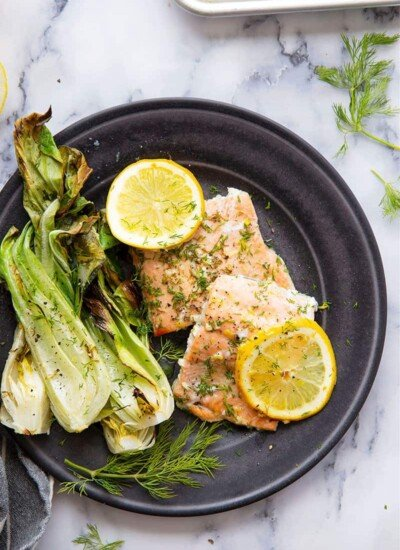 Lemon dill salmon with tender baby bok choy bakes up entirely on one sheet pan in 35 minutes for an easy, flavor-packed weeknight dinner!
