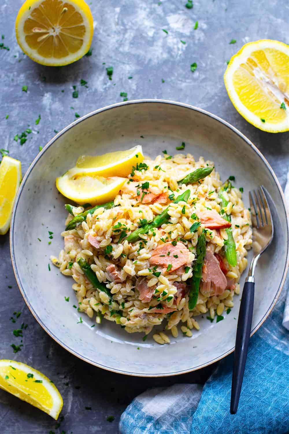 This creamy lemon orzo skillet is loaded with smoked salmon and tender asparagus spears in a rich lemon mascarpone sauce. -  ready in less than an hour with a handful of ingredients!