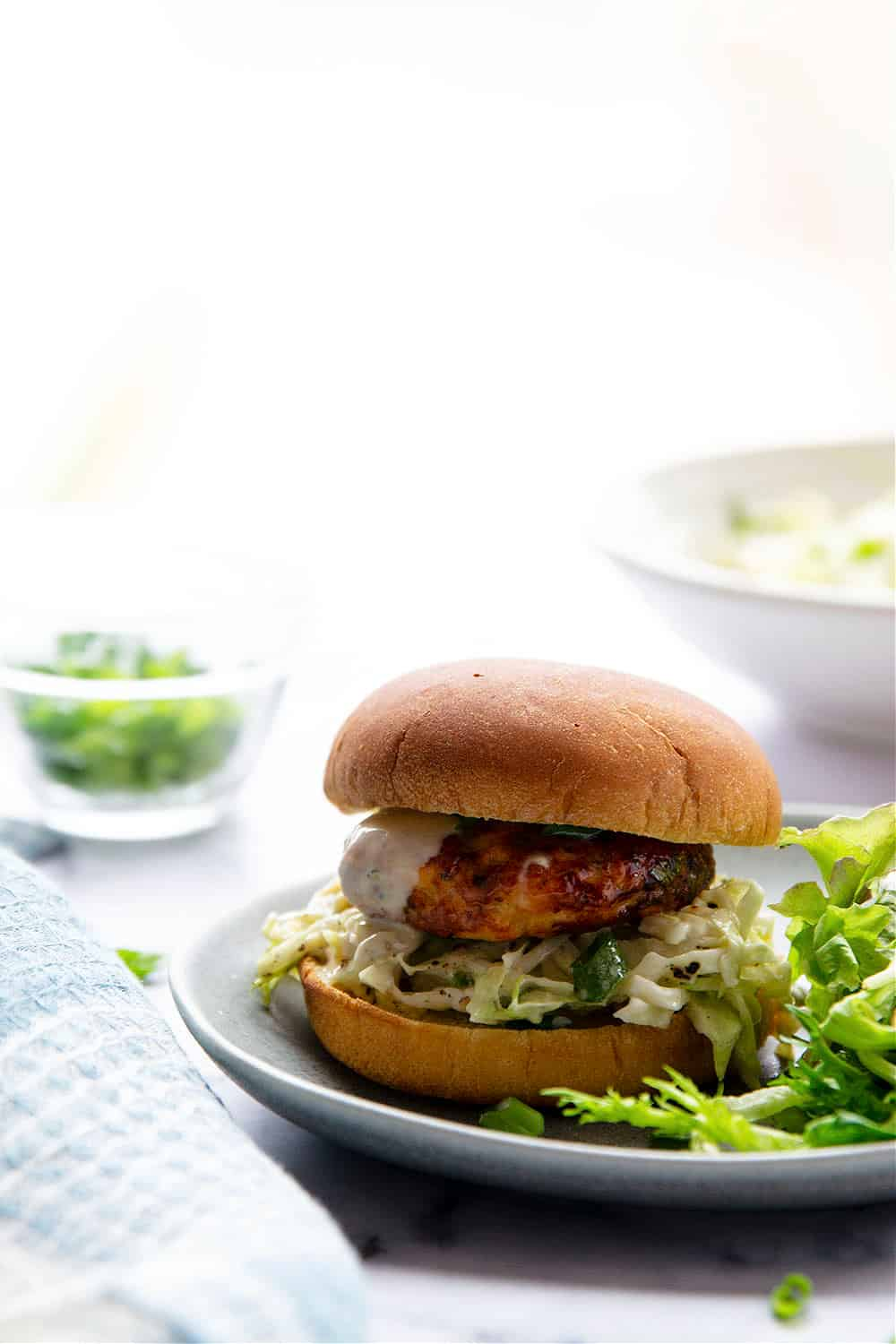 Air fryer salmon patties are perfectly juicy and use fresh salmon for the best flavor! Pile these salmon patties in a soft bun with lots of flavorful tahini slaw.