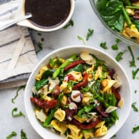 Tuscan tortellini salad is packed with tangy sun-dried tomatoes, fresh baby spinach, and tossed in a sweet honey balsamic dressing. This colorful salad is perfect for meal-prepping and makes an incredible cookout side dish!