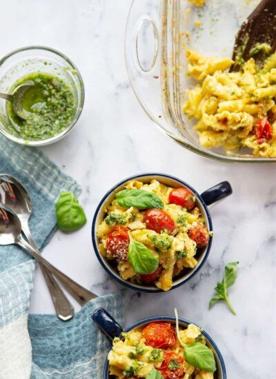 Baked with juicy bursting cherry tomatoes and swirled with fresh basil pesto, this bursting tomato macaroni and cheese is exploding with fresh flavors and impossible to only have one bowl of!