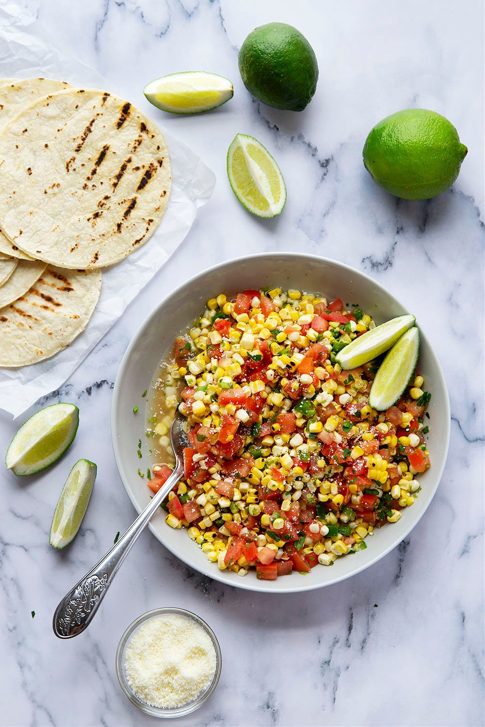 Grilled chipotle steak tacos feature juicy grilled steak with a punch of smoky heat and piled high with a flavorful charred sweet corn salsa!