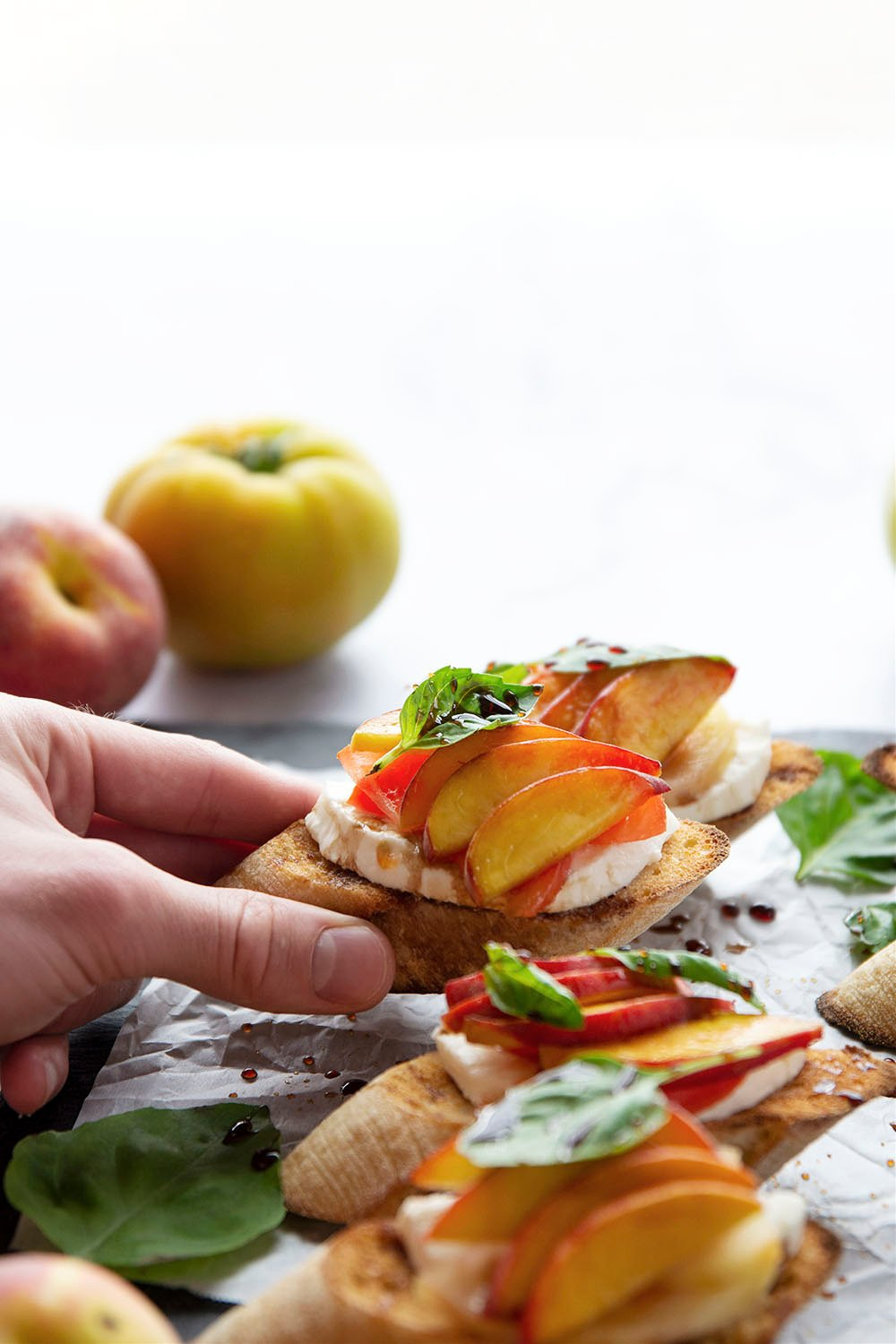 Juicy peaches and all the classic caprese ingredients collide in this summery caprese peach bruschetta that's quick to whip up and perfect for summer entertaining!