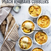 These mini peach rhubarb cobblers have a perfectly sweet and tangy rhubarb peach filling with a classic buttery biscuit topping.